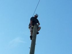 Matt climbs to top of pole