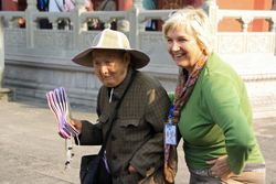 Tourist with old man at Fengdu Ghost City on Yangtzee Cruise