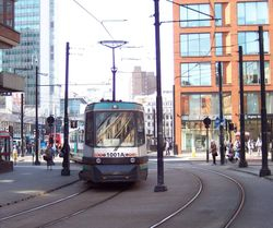 T68 No. 1001 departing Piccadilly Gardens
