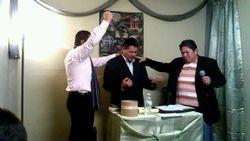 Evangelist Kenny and Eddie Miranda pray for Pastor Tulio