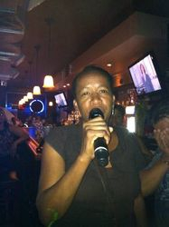 Bridget sharing some Bob Marley with the crowd at 502 Bar Lounge's Social Saturday Night Karaoke!
