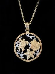 Two tone 14k gold turtle shell & starfish pendand