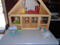 Plan Toys Classic Wooden Dollhouse Complete with Furniture & Family - $130