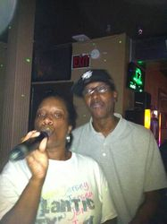 """Khady and D making their contribution to """"We Are The World"""" at 502 Bar Lounge's Social Saturday Night Karaoke!"""