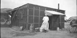 """""""Deluxe"""" tar paper shack"""