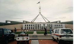 Tom's K75RT & Camper Trailer at Parliment House Canberra on the way to 1996 AGM Hobart - Feb 1996
