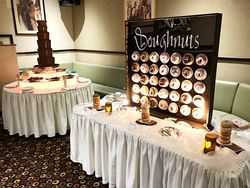 Donut wall and chocolate fountain package.