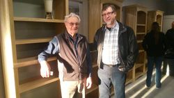 Bernie & Fred stand beside their handiwork of shelves for the new MCC store