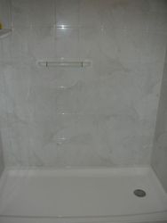 After: Shower w/Silver White Marble walls.