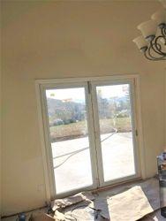 Repaired drywall around door