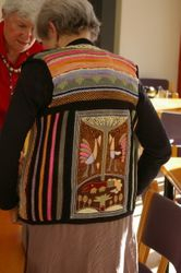 "The back of the waistcoat displaying the ""Croc of the Walk"" panel embroidered by the wonderfully talented Shangaan people"