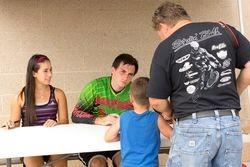 Signing autographs