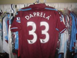 Fabio Deprala's bench worn and signed poppy shirt
