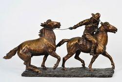 Le cowboy gardien de chevaux