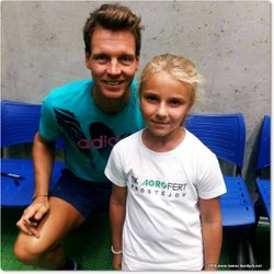 Tomas Berdych and a young tennis fan