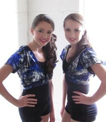 a pair of happy jazz dancers, backstage