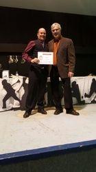 Conrad presents BTC coaching certificate to Murray