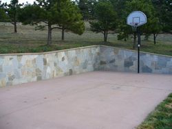 Quartzite stone veneer on concrete with Brownstone cap bullnosed Near Boulder Colorado