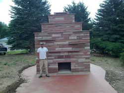 2 sided gas Fireplace outdoor Boulder Red rock strip stone from Lyons one side is gas one side is wood burning