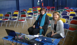Karen and Tricia set up sound with the band.
