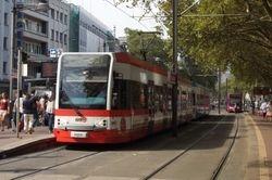 K4000 tram in Reissdorf Kolsch livery, at Neumarkt.