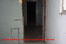 Outside Hallway of 3rd house. Light above doorway.