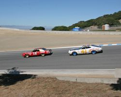 Race winning 1971 Chevrolet Monte Carlo leads away from the Corkscrew