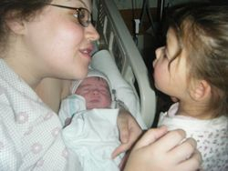 Abby introducing Rebecca to new sister.