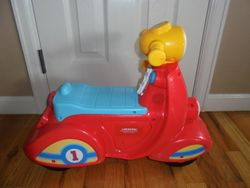 Fisher Price Laugh & Learn Smart Stages Scooter - $23