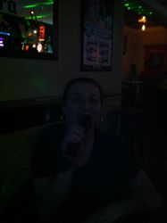 Joanne gracing us with a song at Legendary Friday Night Karaoke!