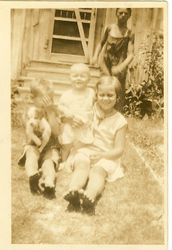Floyd, Deery, Catherine and Edward Manning in back of old Manning House (burned 1940's) - 1932