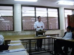 Student giving lesson to the Kollel