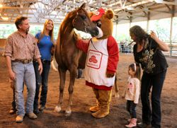 "Stallion Jamaal Khan kissing  ""Niegh-Bear"" the State Farm Mascot"