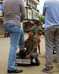 5 Shoeshine boy Pawan, in Lajpat Nagar market, New Delhi