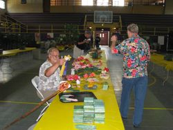 Wally giving Dr. Dave a head table ribbon from the New Orleans show.