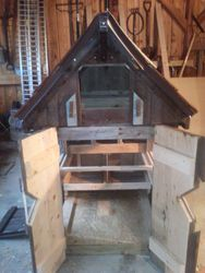 small chicken coop with doors open