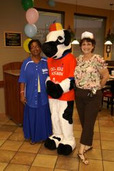 Mrs. Cochrane and Mrs. Leifer with the cow