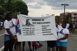Elizabeth & Kemissa holding KSDS banner