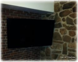 tv wall mount installation on full motion bracket on brick wall