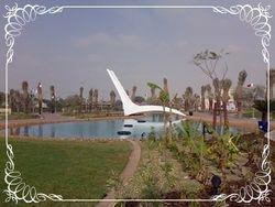 Princess Sabeeka park pond with footbridge