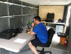 Matt, W1SKE operating Field Day 2020 in the partially completed trailer