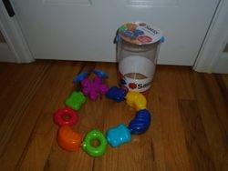 Sassy Developmental Bath Toy, Pop and Pour Pals - $8