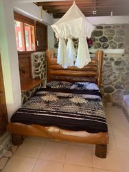 Gecko Room Queen size bed with mosquito net