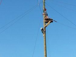Another brave little girl climbing to zip line platform