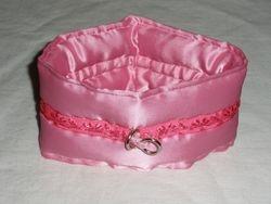 Pink padded satin choker.