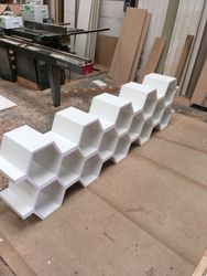 Bespoke shelving for exebition stand.