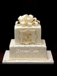 white and gold anniversary cake