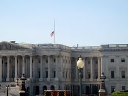 Flag at Half Staff Above East Front of Exterior of New House Wing of US Capitol Building to Honor Lying in Repose of Associate Supreme Court Justice Ruth Bader Ginsburg from Northeast
