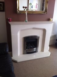 Inset Gas Fire an Limestone Fire Surround Installation. 3.