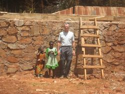 Eric with village children at the water tank platform